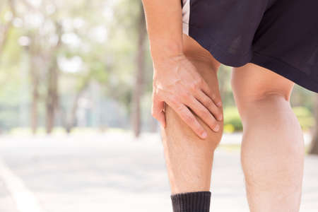 Cramp in leg while exercising. Sports injury concept Stock Photo - 58437758