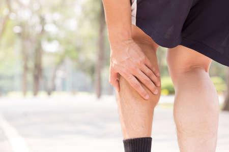 leg calf injury: Cramp in leg while exercising. Sports injury concept