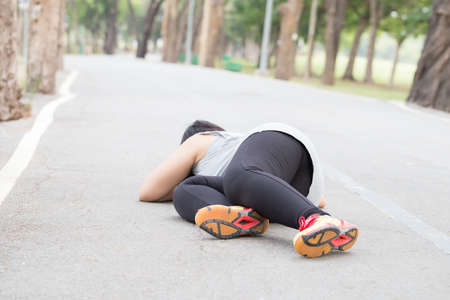 stumble: Sport accident injury. stumble and fall while jogging Stock Photo