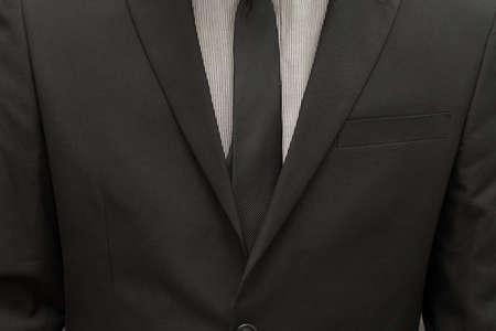 tie necktie: Businessman wearing suit and tie necktie