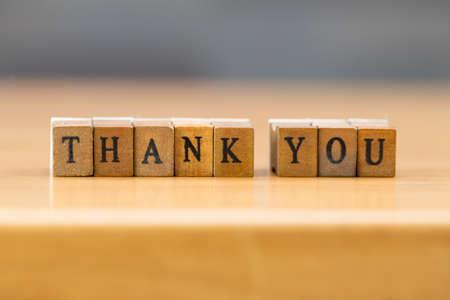 wood block: Thank you. word written on wood block Stock Photo