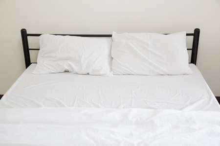 cookware: White bed sheets and pillows Stock Photo