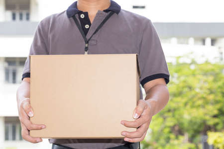 delivery box: Delivery man holding a parcel box. Delivery service concept Stock Photo