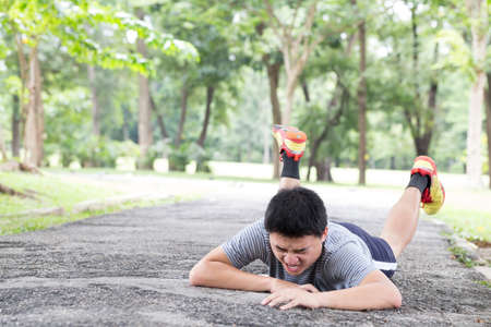 Sport accident injury. stumble and fall while jogging Stock Photo