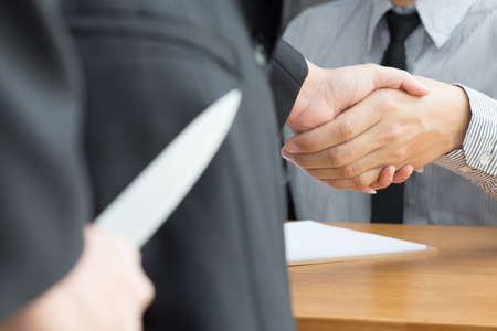 extortion: Blackmail concept, Business handshake and doing agreement