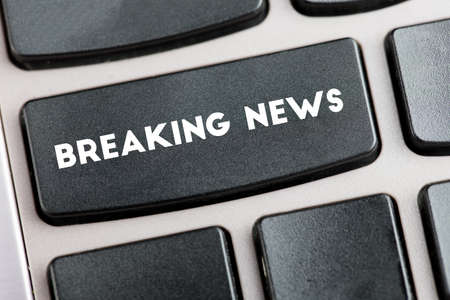 breaking: Black keyboard with the words breaking news
