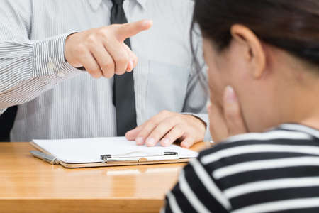 scolded: Businesswoman getting intimidated after scolded by boss
