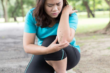 stumble: Sport injury. stumble and fall while running in the park Stock Photo