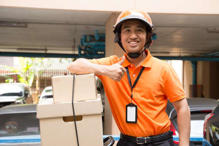 Box on motorcycle with delivery man