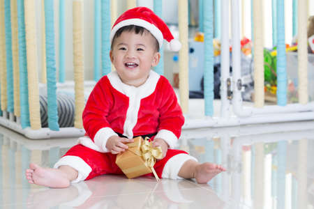 Baby in santa dresses on christmas day