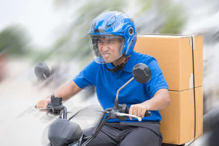 Deliveryman ride motorcycle service, Fast and Free Transport Delivery Stock Photo