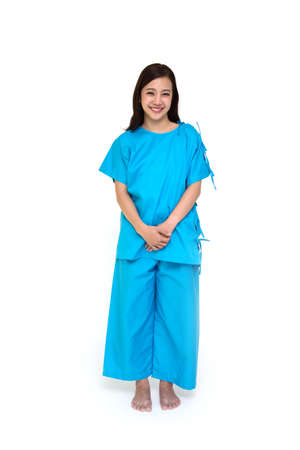 Young Asian woman smiling and wearing patient outfits stand on white background