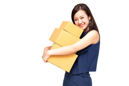 Happy Asian woman holding package parcel box, Delivery courier and shipment service concept Фото со стока
