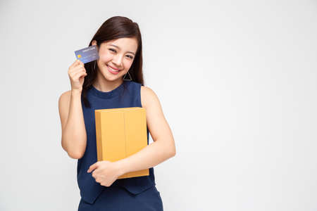 Happy Asian woman holding package parcel box and credit card, Delivery shipping service and shopping online concept