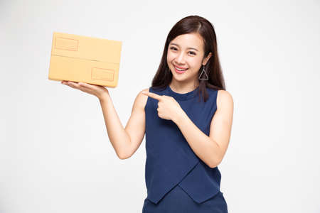 Happy Asian woman holding package parcel box, Delivery courier and shipment service concept