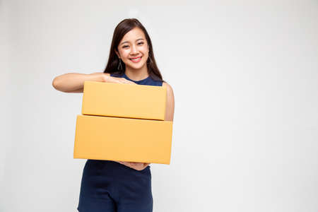 Happy Asian woman holding package parcel box, Delivery courier and shipping service concept