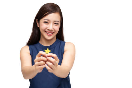 Happy Asian business woman showing star sign isolated on white background, Customer experience and best excellent services rating for satisfaction concept 免版税图像