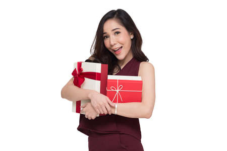 Happy beautiful asian woman smile with red gift box and copy space white living room background. Teenage girls in love, Receiving gifts from lovers. New Year, Christmas and Valentines Day concept