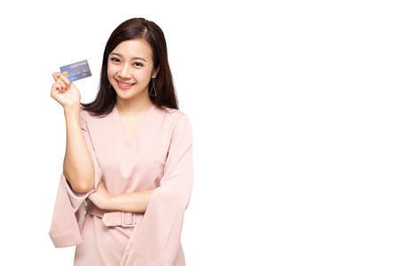 Happy Asian woman holding credit card or cash advances, Pay instead of money and specially curated benefits for lady card concept