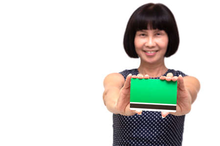 Mature Asian senior woman showing book bank account, Retirement planning and mutual funds concept