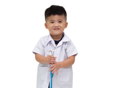 Smiling little boy in medical uniform playing with stethoscope isolated on white background, Asian baby two year one month old Stock Photo