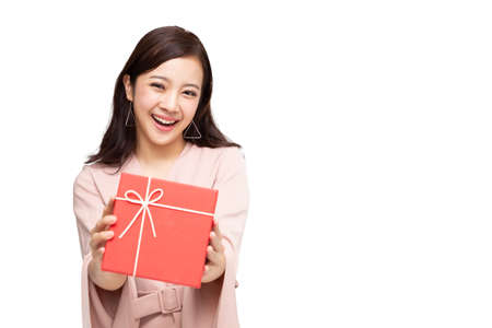 Happy beautiful asian woman smile with red gift box isolated on white background. Teenage girls in love, Receiving gifts from lovers. New Year, Christmas and Valentines Day concept