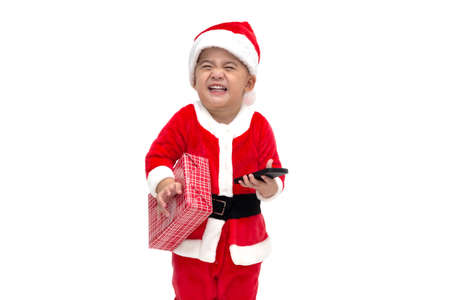 Asian baby boy santa claus laughing smiling and holding gift box in Christmas festival isolated on white Standard-Bild