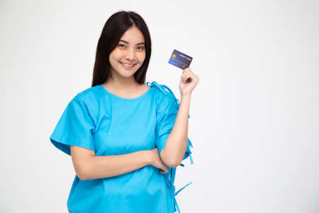 Young Asian beautiful woman patient showing credit card isolated on white background, Insurance policy by bank concept