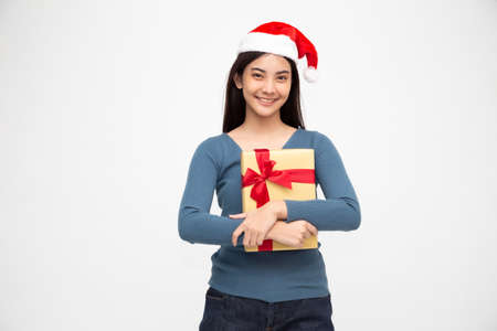 Happy beautiful asian woman smile with gold gift box isolated on white background. Teenage girls in love, Receiving gifts from lovers. New Year or Christmas concept Stock Photo