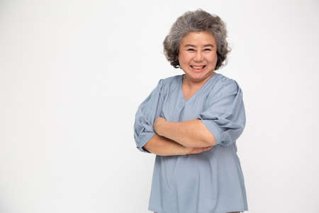 Portrait of asian senior women with arms crossed and smile isolated over white background, Mature smiling and looking at camera, Happy feeling concept
