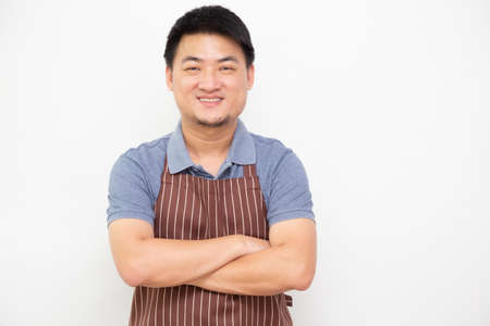 Portrait of Asian workers fresh market with brown apron standing with arms crossed isolated on white background
