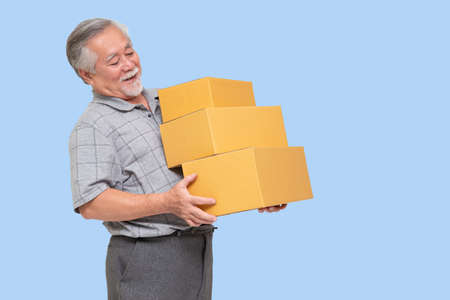 Happy asian senior man holding package parcel box, Delivery courier and sell product with online shipping service concept Фото со стока