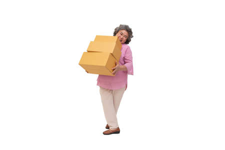 Happy asian senior woman holding package parcel box isolated on white background, Delivery courier and shipping service concept Фото со стока