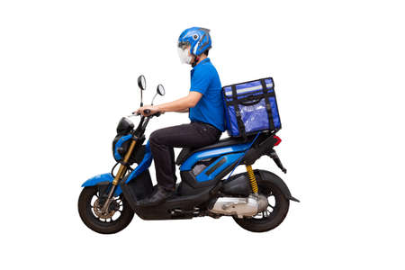 Delivery man wearing blue uniform riding motorcycle and delivery box. Motorbike delivering food or parcel express service isolated on white background Archivio Fotografico