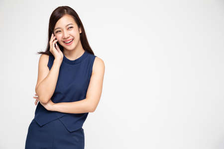 Asian woman smiling while talking on the phone isolated on white background, Phone conversation concept 免版税图像