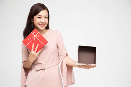 Happy beautiful asian woman smile and holding gift box isolated on white background. Teenage girls in love, Receiving gifts from lovers. New Year, Christmas and Valentines Day concept