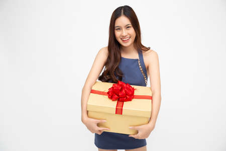 Happy asian woman smile with gold gift box isolated on white background. Teenage girls in love, Receiving gifts from lovers. New Year, Christmas and Valentines Day concept