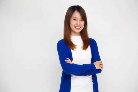 Portrait of happy young asian woman with arms crossed and smile isolated over white background 免版税图像