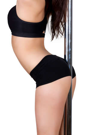 Pole dance Girl, girl standing with her back against a pole with a white backround. photo