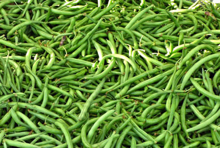 Green beans for sale at the Cherry Street Farmers Market in Tulsa Oklahoma. Morning in summer.