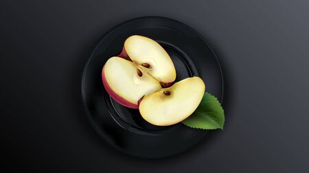 Sliced red apple on a black plate.