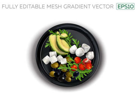 Feta and Mozzarella cheese with vegetables on a black plate.