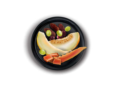 Melon, papaya, grapes and dates on a black plate. Zdjęcie Seryjne
