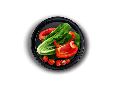 Bell pepper, lettuce and cherry tomatoes on a black plate. Zdjęcie Seryjne