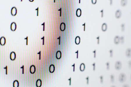 Binary code on a computer screen Banco de Imagens