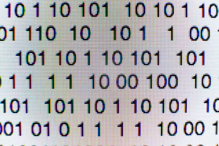 Binary code on a computer screen 写真素材