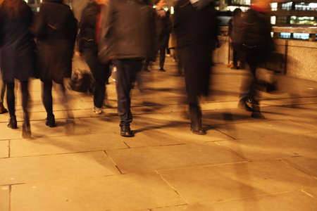Commuters at night on London Bridge London, England