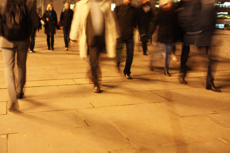 Commuters at night on London Bridge Banco de Imagens