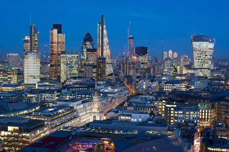 Elevated view of the financial district of London at night, England 写真素材