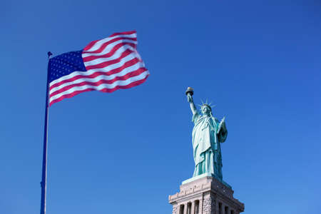 Statue of Liberty and the US Flag, New York City, New York, USA
